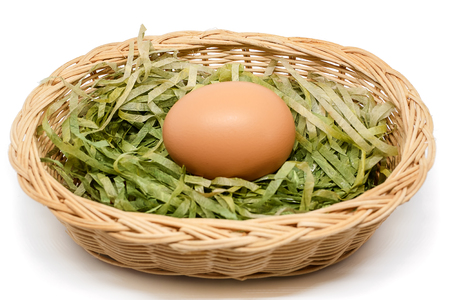 Egg in the wicker basket on white background for healthy food concept