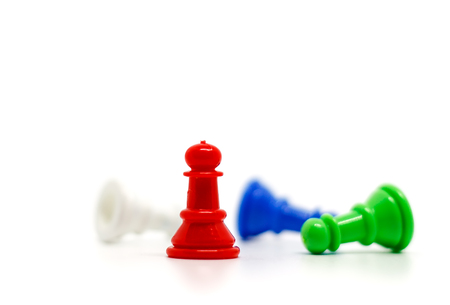 Selective focus of red chess pawn on blurred others against white background for leadership concept