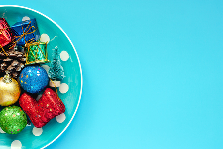 Polka dot plate of Xmas ornaments and decoration on blue background for Christmas day and holidays concept Stock Photo