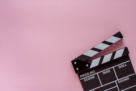 Movie clapper board on pink background for filming equipment