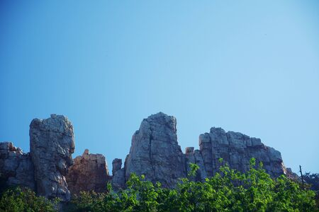 Rocky cliff and mountain against blue sky background for nature concept 版權商用圖片