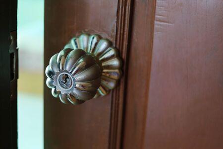 Slightly opened wooden door to the room. 版權商用圖片