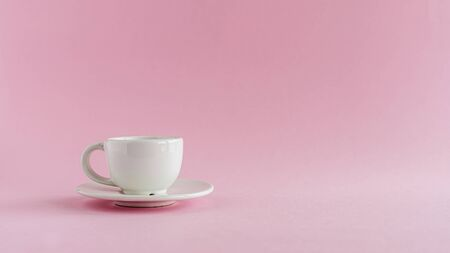 White coffee cup on pink background for drinks, beverage, utensil and dishware concept
