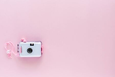 Camera waterproof toy on pink background with copy space Imagens