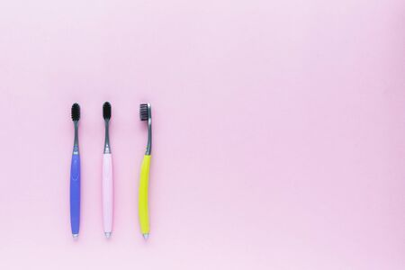 Set of toothbrush on pink background for dental care concept Imagens