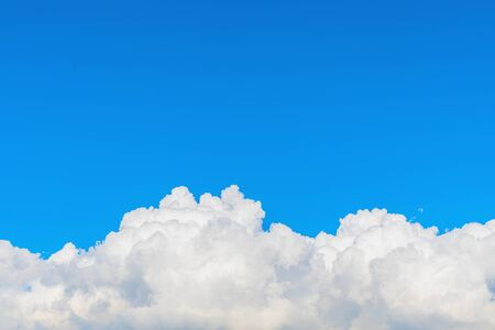 Fluffy cloud against blue sky background for summer and nature concept Imagens - 148160634