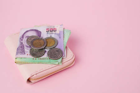 Thai currency banknote and money coins with wallet on pink background for business, finance, investment and saving money concept Imagens - 150884306