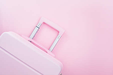 Pinky luggage on pink pastel colored background for traveling concept Imagens - 151435018