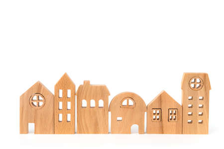 Wooden house model on white background for housing and property concept