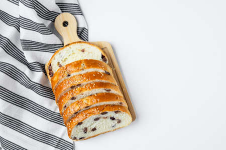 Vegan sliced fine whole wheat bread on white background for bakery, food and eating concept Imagens