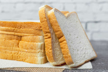 Sliced bread on dark grunge background for bakery, food and eating concept