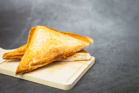 Sandwich bread on dark background for bakery, food and eating concept Imagens