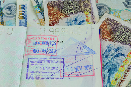 Laos visa and Laos money photo