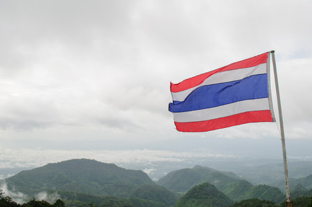 Flag of Thailand with mountain background photo