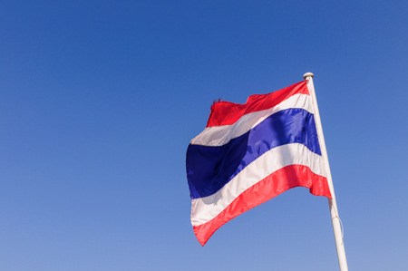 Flag of Thailand on blue sky background photo