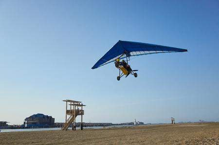 beach with paramotoring