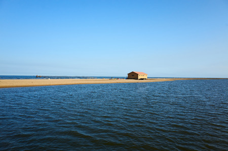 beach scenery with small building Editorial