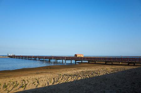 beach with bridge & small building