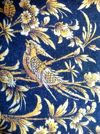 Golden bird and flowers carpet pattern Stock Photo