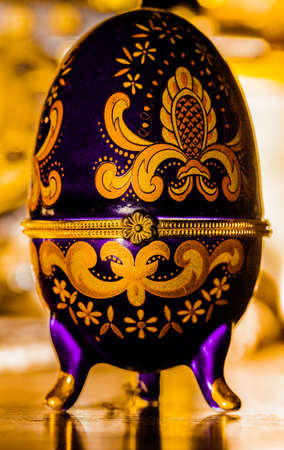 Painted ornamental egg on stand Stock Photo