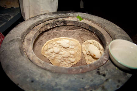 Naan Bread oven, Indian food bread baking  Stock Photo