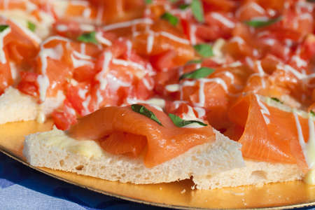 Salmon with capers and tartar sauce on toast