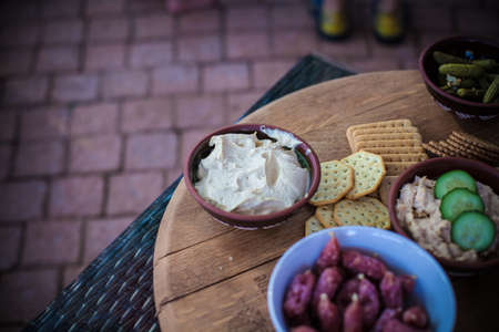 crackers and dip on wood table