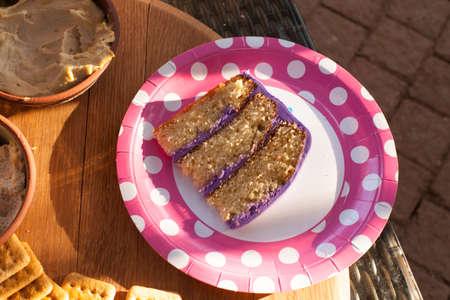 Sliced cake on paper polka dot plate Stock Photo