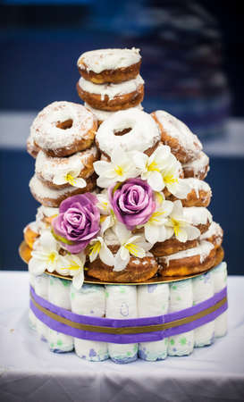 Baby shower cake made from doughnuts
