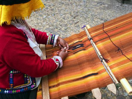 cusco province: Inca woman making handmade textile in Cusco, Peru