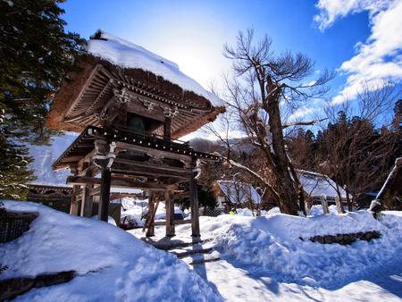 gassho zukuri: Japanese shrine coverd by snow in Shirakawa-go, world heritage village