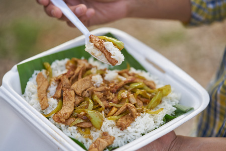 woman eating rice and Stir Fried Green Chili with pork.
