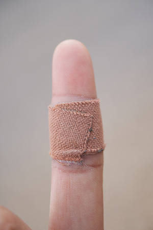 medical dahesive plaster on forefinger.