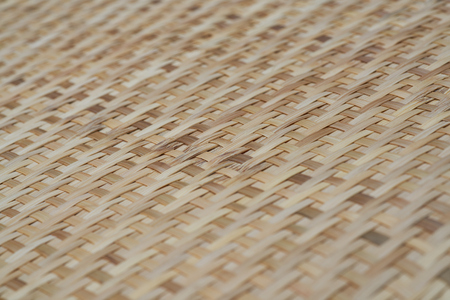 close up rice-winnowing basket made  form bamboo for background. Reklamní fotografie