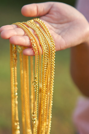 gold jewelry in lady hands. Stock fotó - 94509034