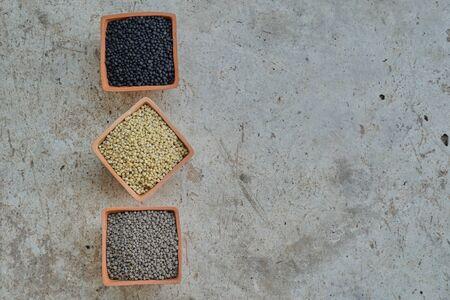 Three color of  Diammonium phosphate (DAP) in clay pots