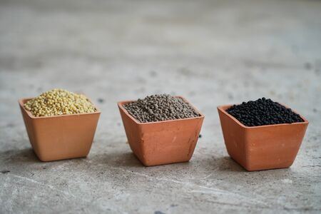 Three color of  Diammonium phosphate (DAP) in clay pots