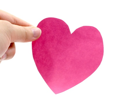 A hand hold a pink heart on white background photo