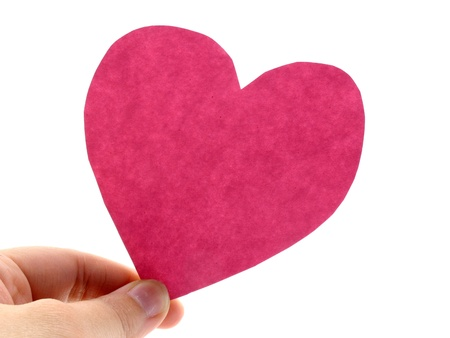 A hand hold a pink heart on white background