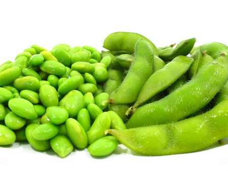 Edamame soy beans shelled and pods on white background