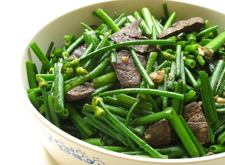 Pork Liver Stir Fried With Flowering Garlic Chives on white background  photo