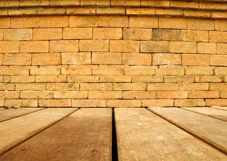 Orange brick wall and brown wood floor Stock Photo - 13035781