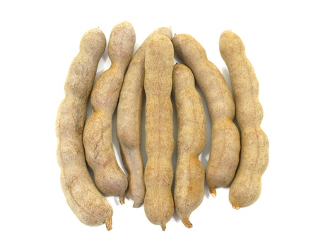 Sweet tamarind on white background photo