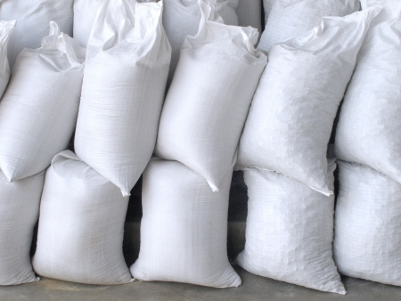 Pile of white sacks full with sand and rock photo