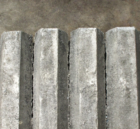 Hexagon concrete pillar on top view lay on concrete floor photo