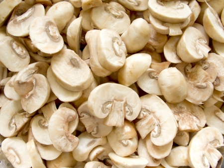 Pile of fresh sliced Champignon Mushroom close up Stock Photo
