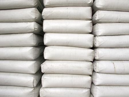 Pile of white plastic sacks in warehouse