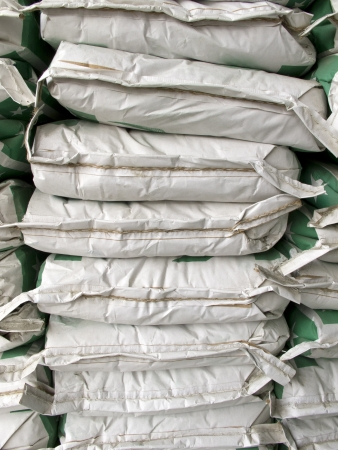 Pile of white paper sacks in warehouse photo