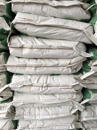 Pile of white paper sacks in warehouse
