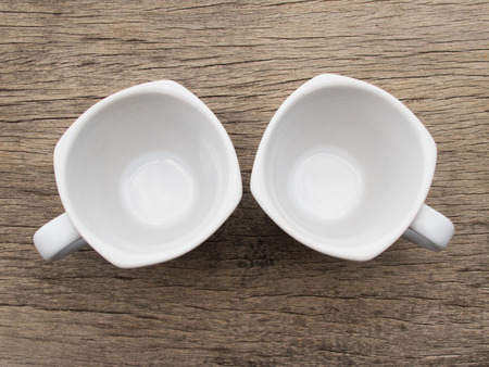 Two blank white teacup on wood